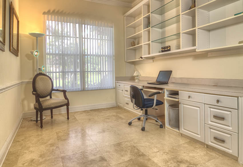 Office area with travertine floor shelves drawers and cabinets