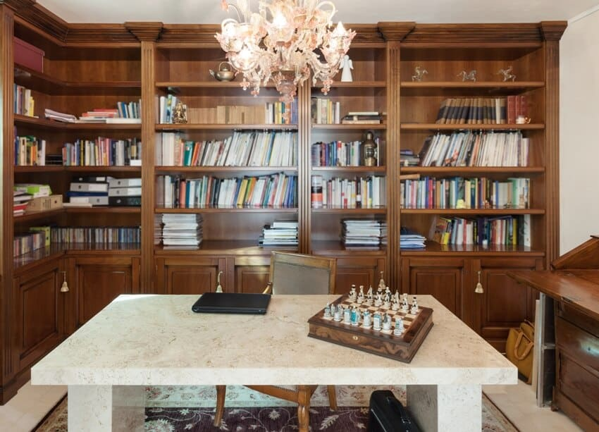 Office in classic style with marble table and traditional bookcase