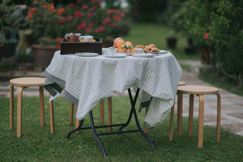 Outdoor table with tablecloth wood stools