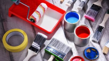 Paint brushes and paint cans