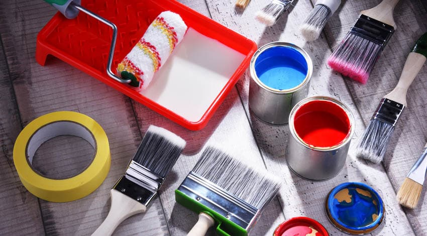 Paint brushes, paint cans, roller and tray