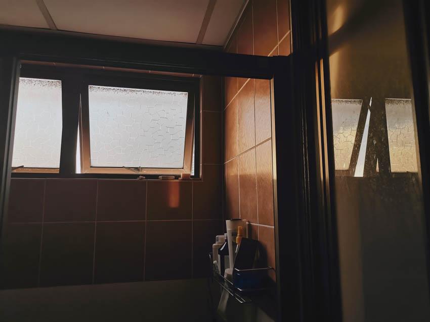 Patterned obscure glass window bathroom