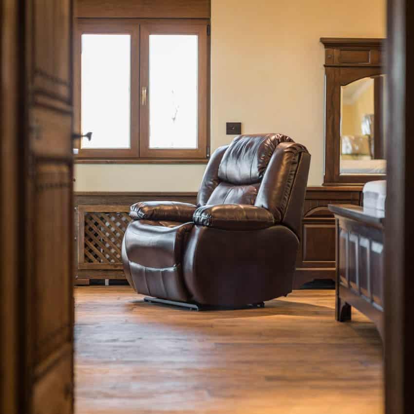 Recliner inside living room wood door flooring