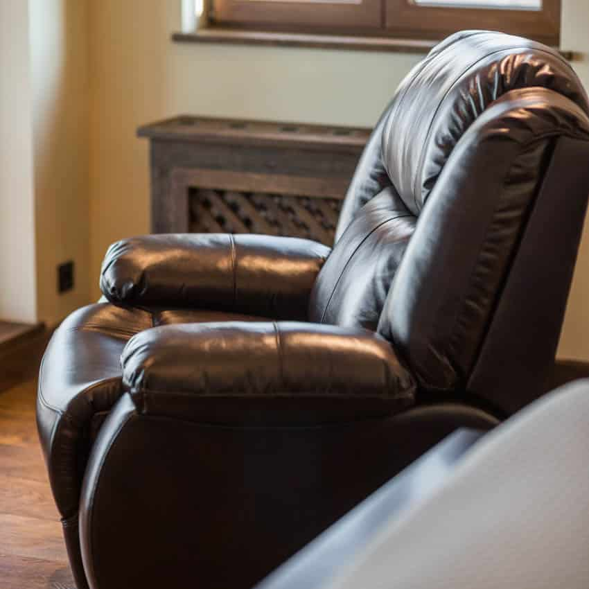 Recliner with brown leather inside living room