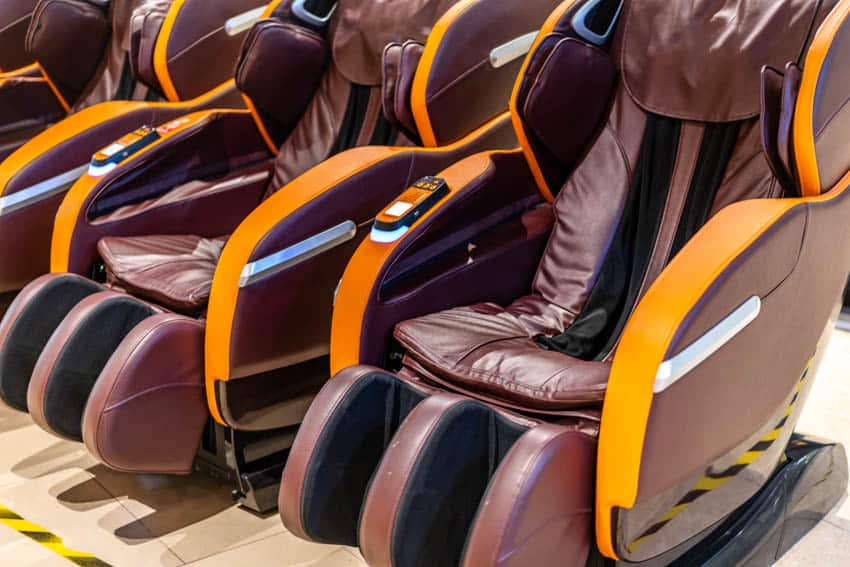 Reclining chairs with massage feature