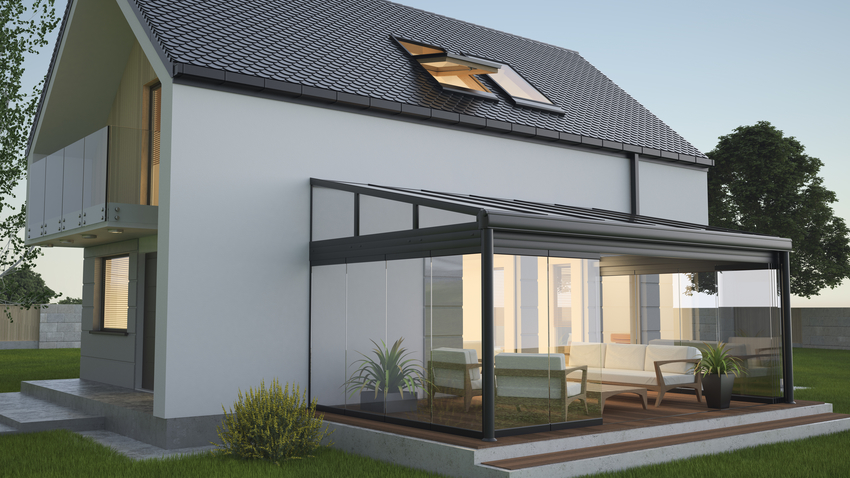Retractable patio enclosure attached to main residence