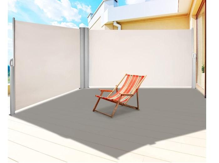 Retractable waterproof divider for outdoor spaces