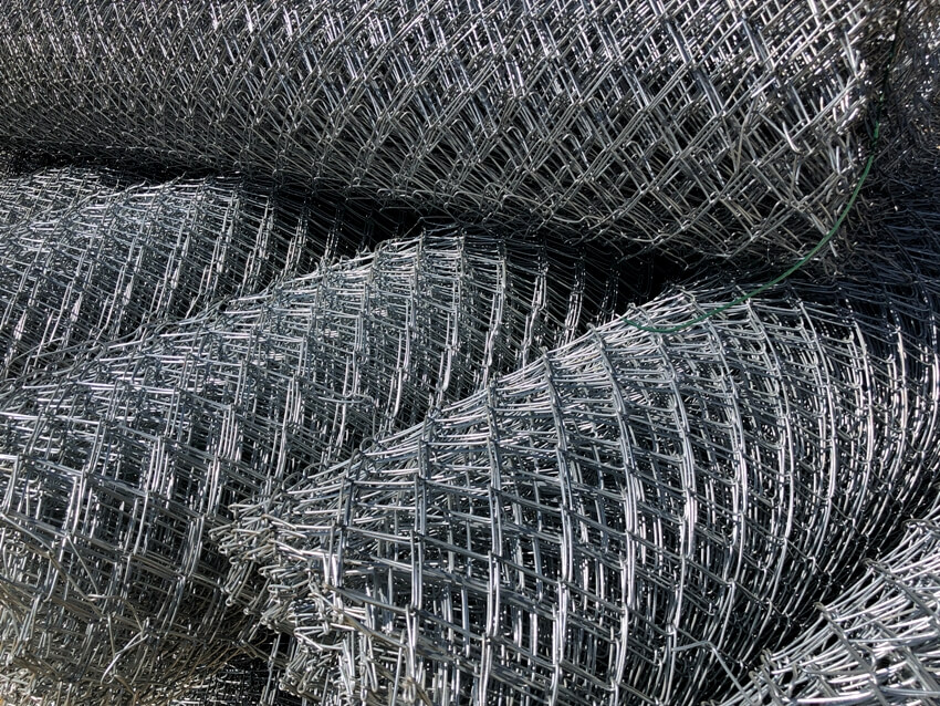 Rolled chain link fence