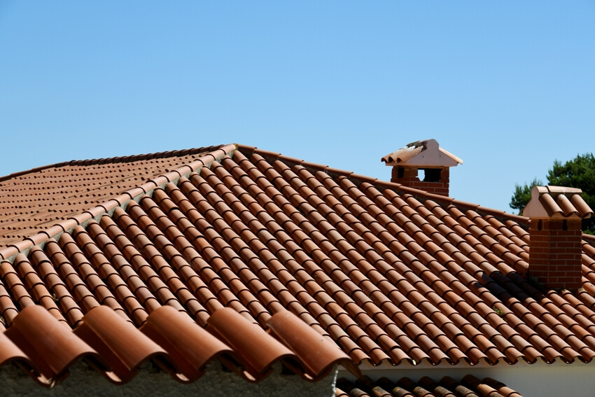 Roof tiles and chimneys on house