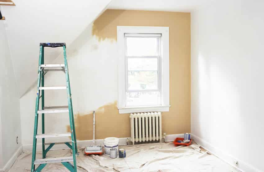 Room renovation with painting materials and ladder