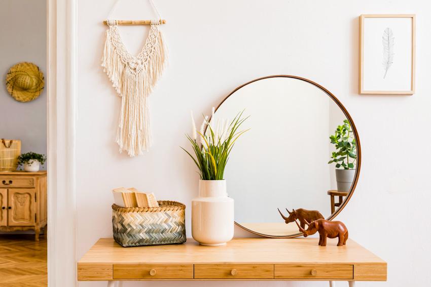 Round mirror on table indoor plants decor