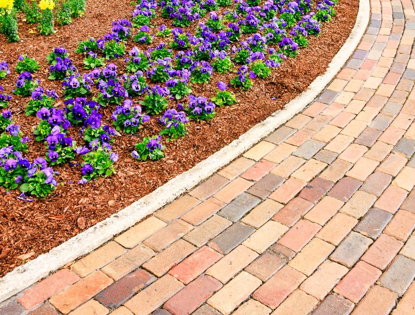 Running bond walkway brick edging flowers