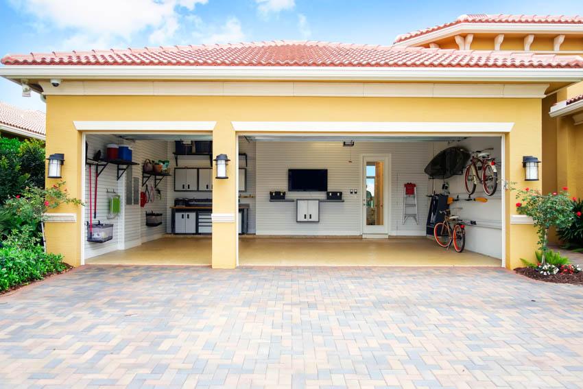 Slate tile driveway leading to open garage