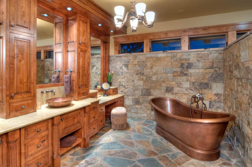 Slate tile floor wood cabinet bathroom mirror copper sink bathtub