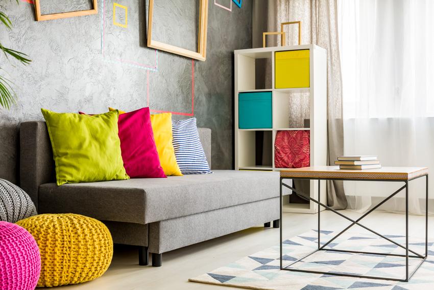 Sofa with loose cushion colorful pillows window curtain