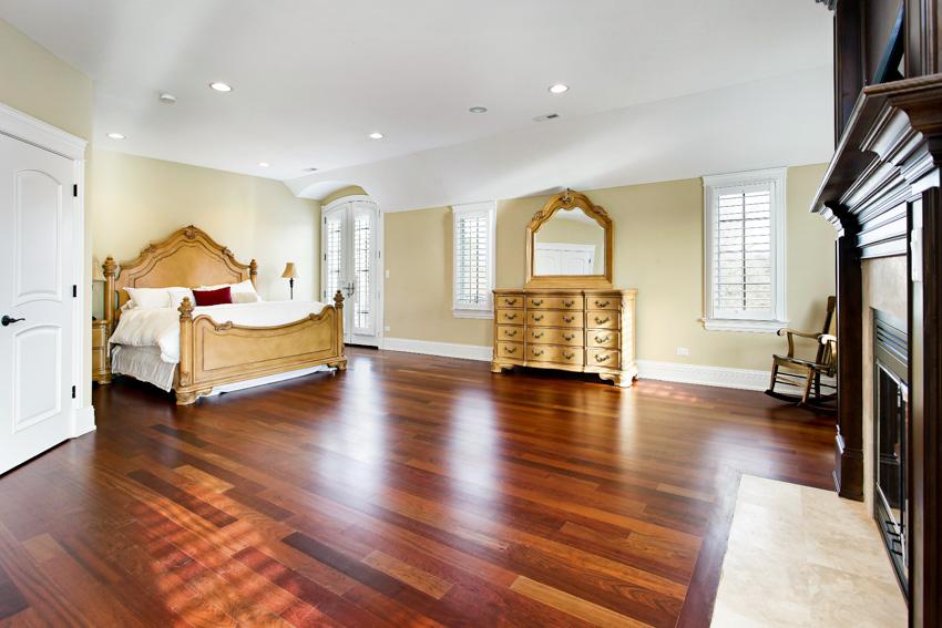 Spacious bedroom with cherry wood floors