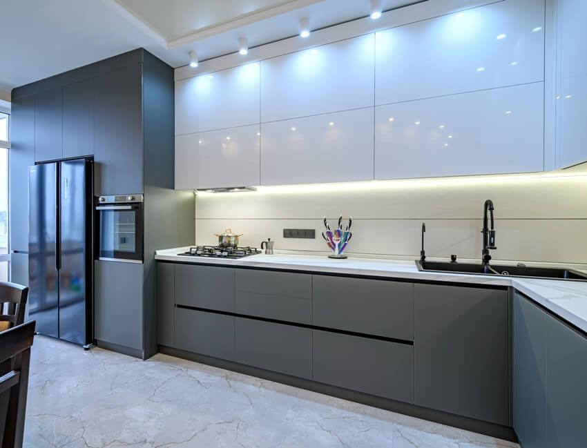 Spacious luxury white and dark grey modern kitchen interior