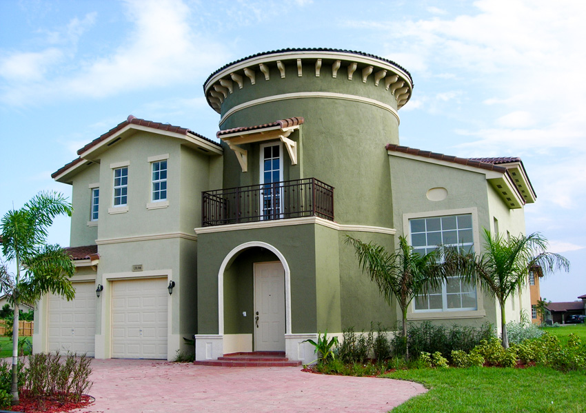 Spanish style house with green exterior paint color
