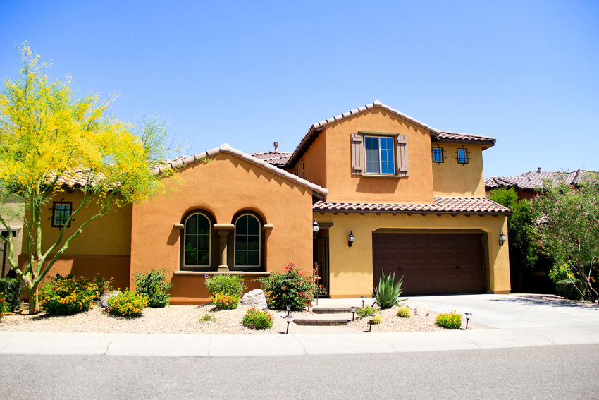 Spanish style house with red and orange exterior paint color