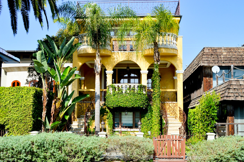 Spanish style house with yellow exterior paint color