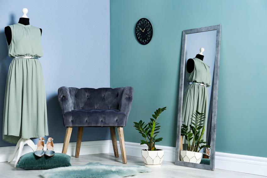 Standing mirror sofa chair green walls