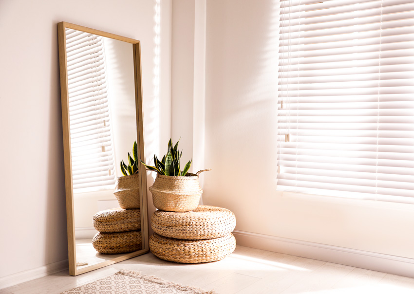 Standing rectangular mirror window white curtain indoor plant