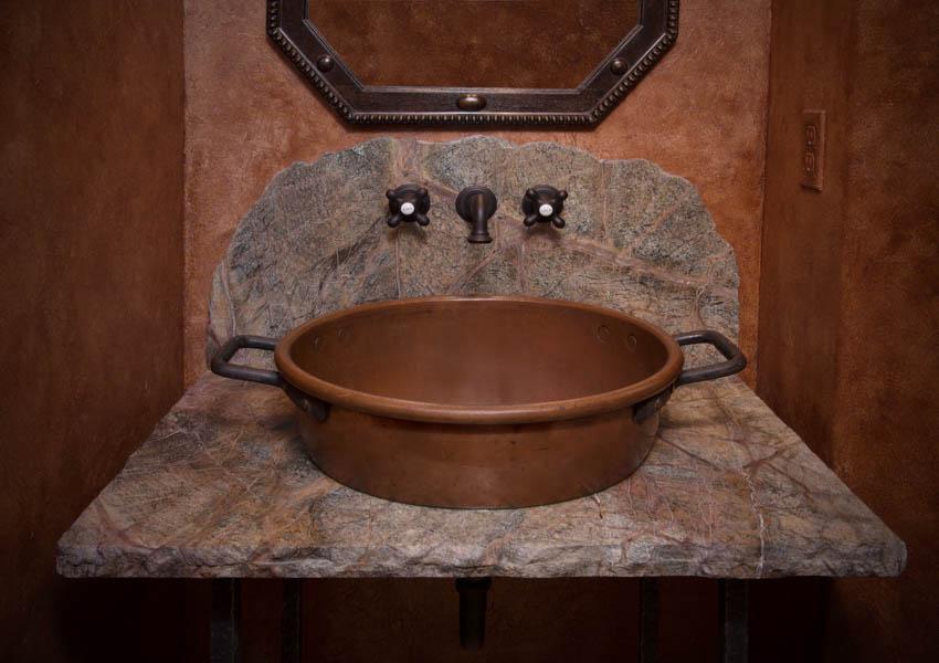 Stone and copper sink bathroom mirror