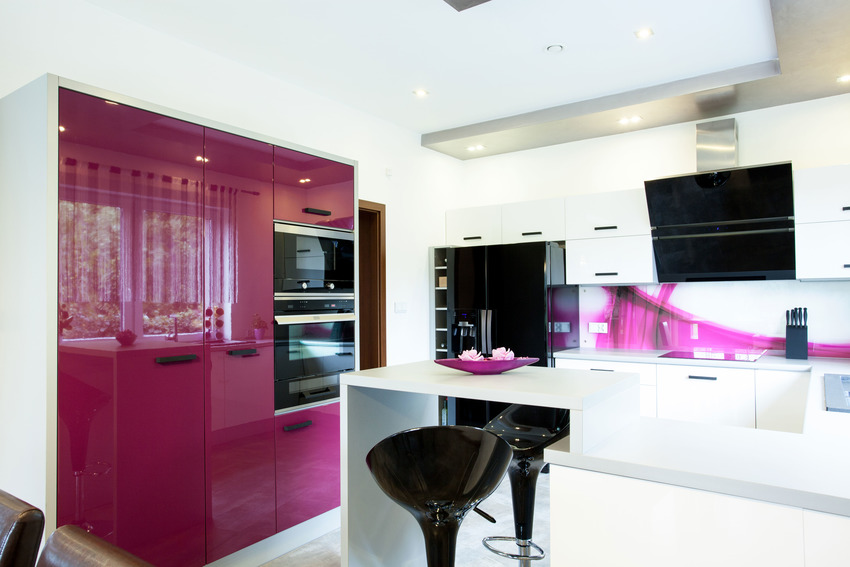 Stylish black pink and white kitchen interior with high gloss kitchen cabinet