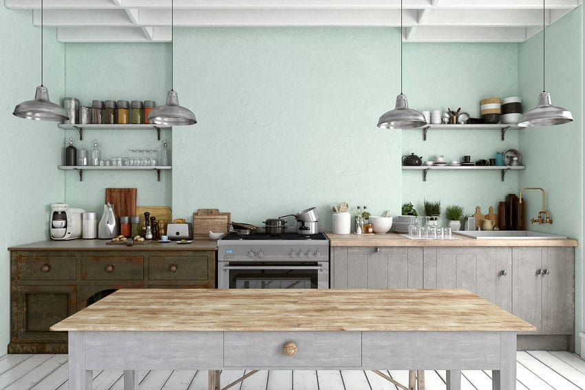 Stylish kitchen interior with light blue walls pendant lights and condiments on display