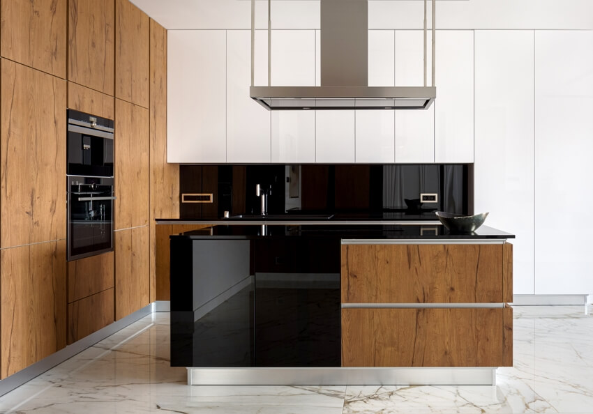 Stylish kitchen with wooden elements and marble floor tiles