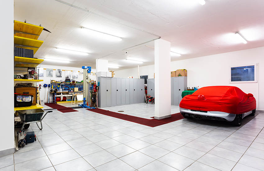 Tandem garage interior with covered car