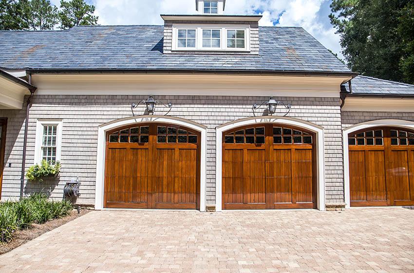 Three car garage with wood doors