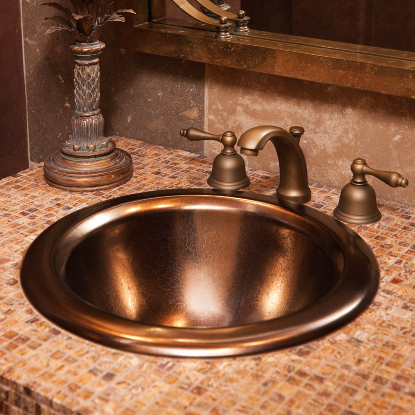 Tiled countertop with copper sink faucet