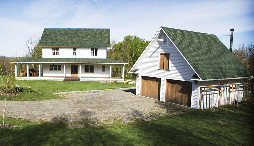 Traditional farm house with detached barn garage