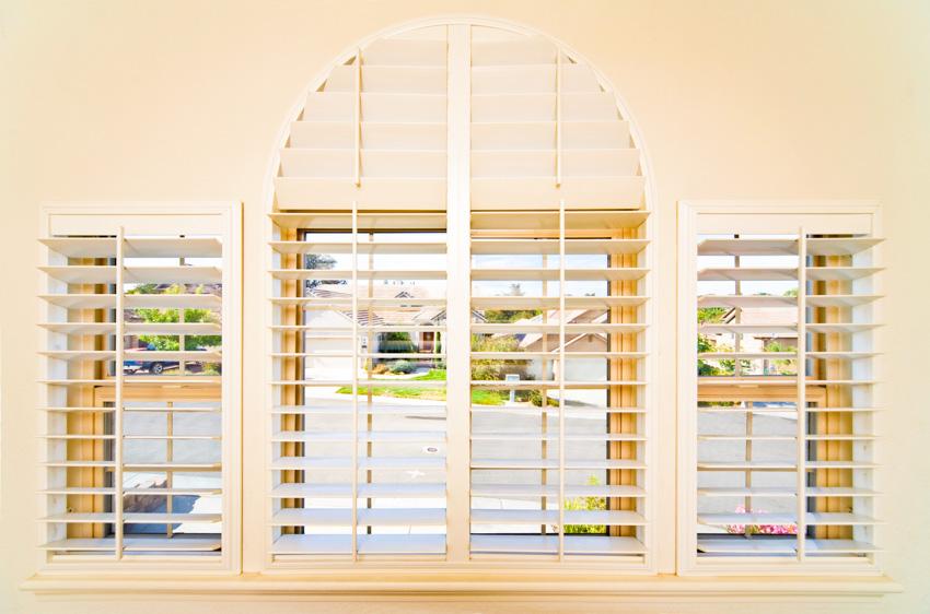 Traditional interior shutters window