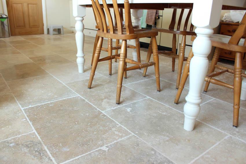 Travertine floor tile wood chairs