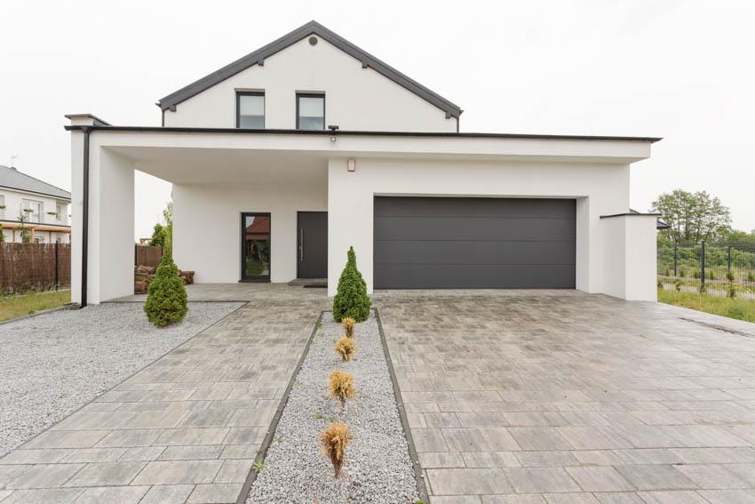 Travertine paver driveway white house with garage