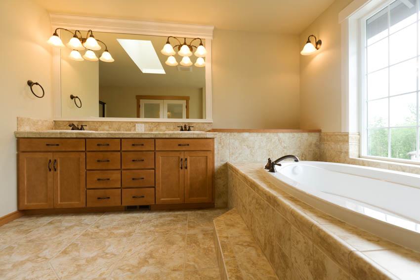 Travertine tub floor wood drawer and cabinet mirror with lighting window bathroom