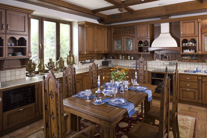Tuscan kitchen wood cabinets stove hood oven dining chair tables window