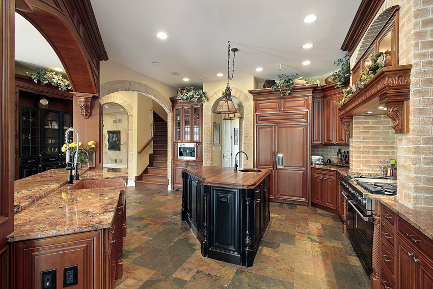 Tuscan style kitchen wood cabinet drawer tile floors center island hanging light oven