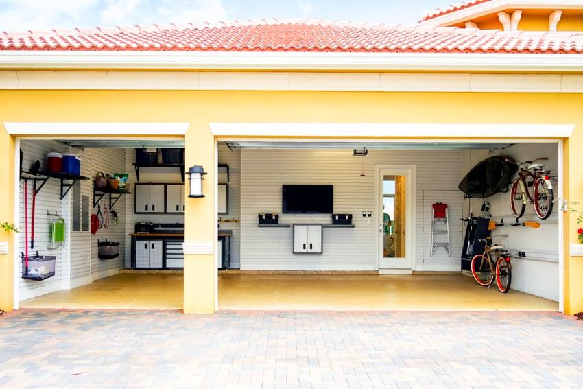 TV in garage paver driveway