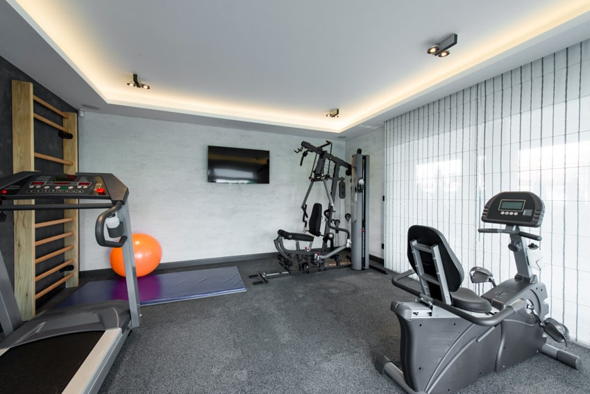 TV mounted on wall house gym garage window blinds