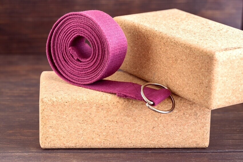 Two cork blocks and violet yoga strap