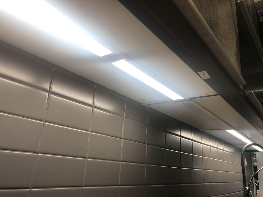 Under cabinet lighting gray tile wall