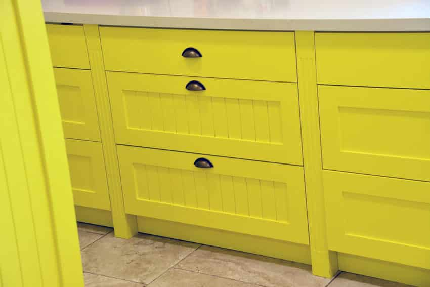Vibrant yellow pantry storage drawers