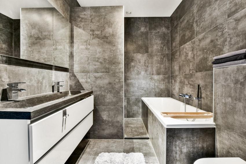 White and gray bathroom with countertop mirror bathtub