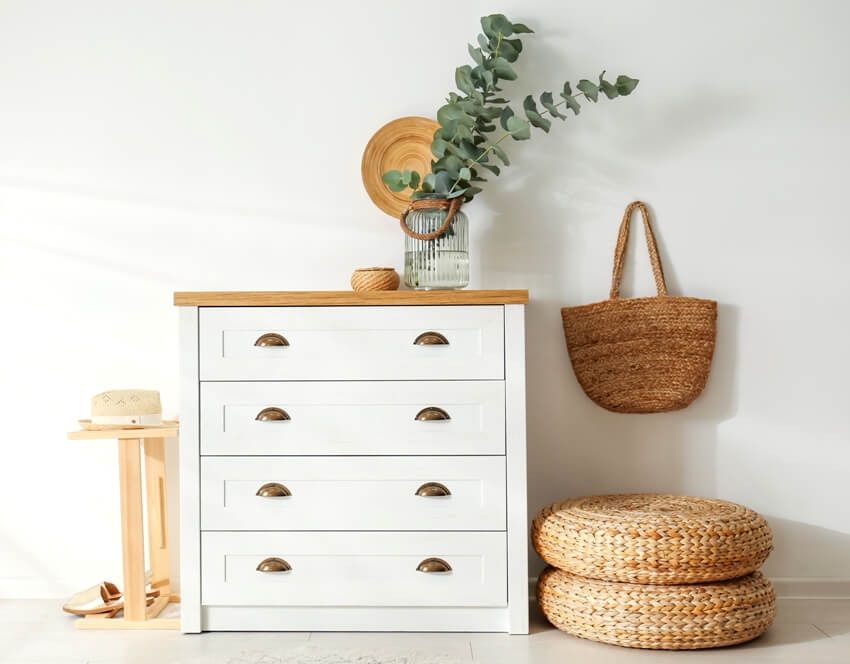 White chest of drawers in stylish room interior