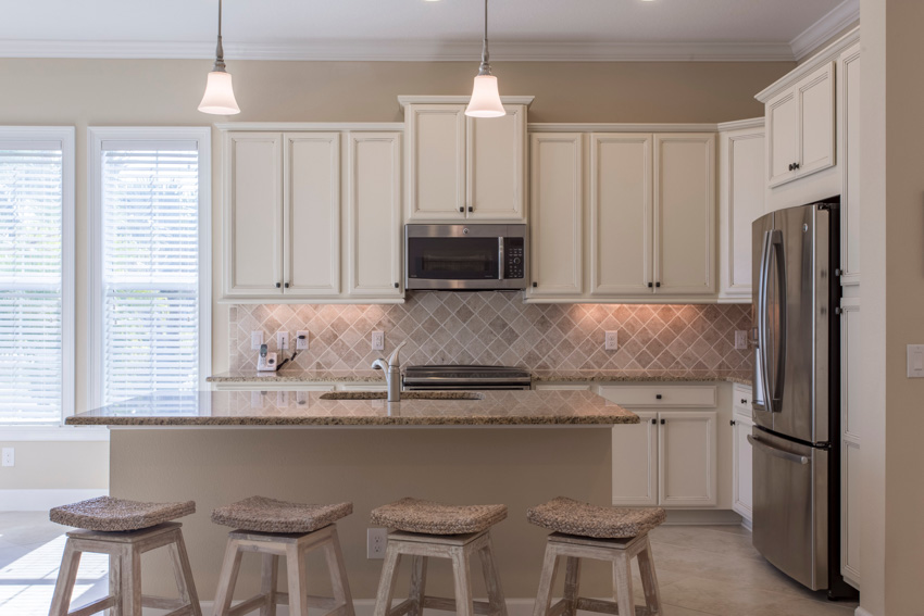 White kitchen with center island countertop backsplash matching