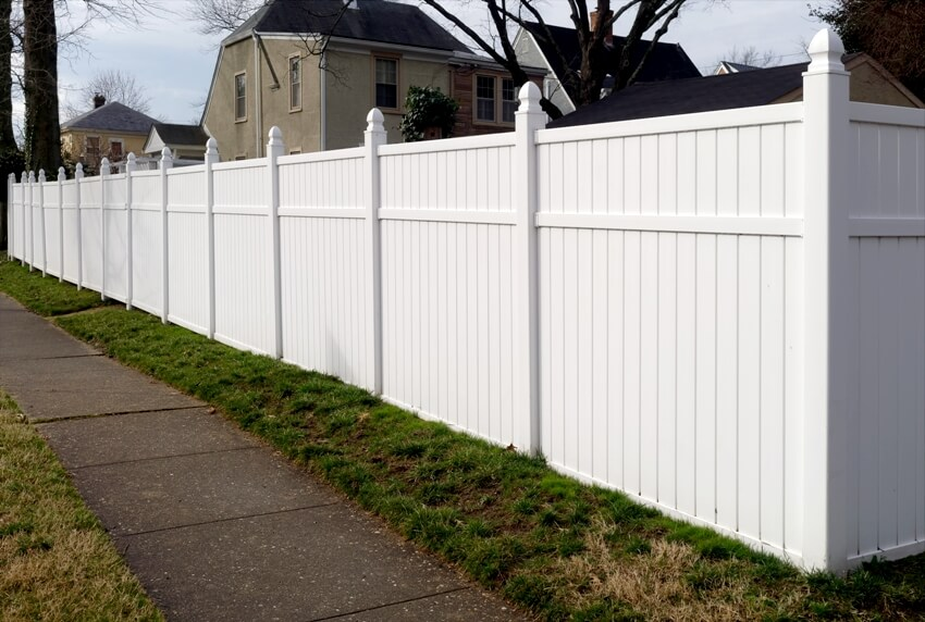 White vinyl fence in residential neighborhood