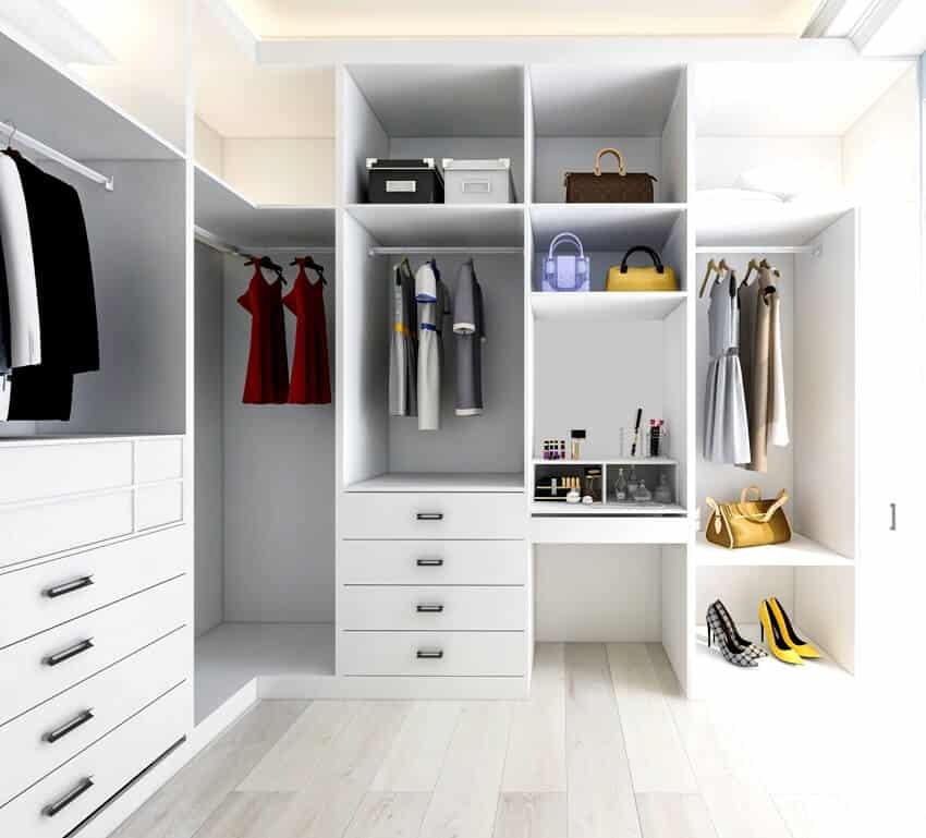 White walk in closet interior with clothes shoes and bags